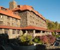 The exterior of the Omni Grove Park Inn against a bright blue sky.