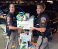Fairfax County deputies carrying donated goods