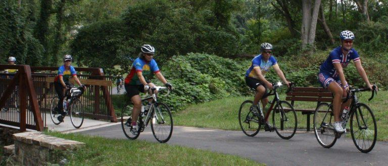 Bicyclists along the Greenway linkage at Reed Creek.