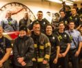 Asheville Fire Department Divison Chief Joy Ponder, third from left, stands with her crew, which has been very supportive as she battled cancer herself.