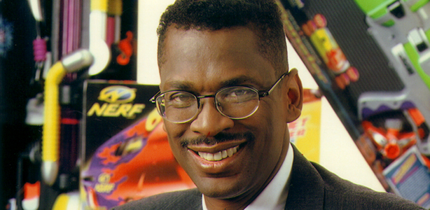 Dr. Lonnie Johnson in front of SuperSoakers.