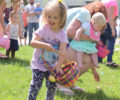 Children searching for hidden Easter eggs.