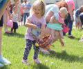Families participating in an Easter egg hunt at Lake Junaluska.
